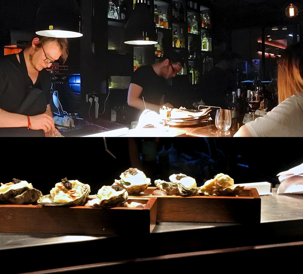 オープン・キッチンでは忙しそうにシェフたちが立ち働いている。下の写真は、私たちは食べなかったオイスターのフライ。美味しそうでした ^^