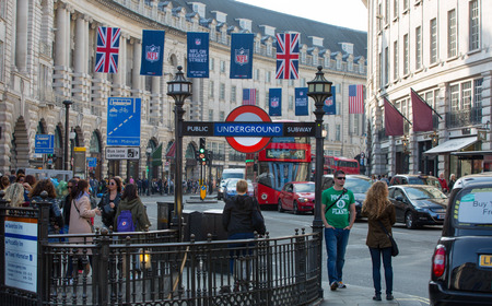 58860339 - london, uk - october 4, 2015: underground entrance at the regent street and lots of people and cars on the road