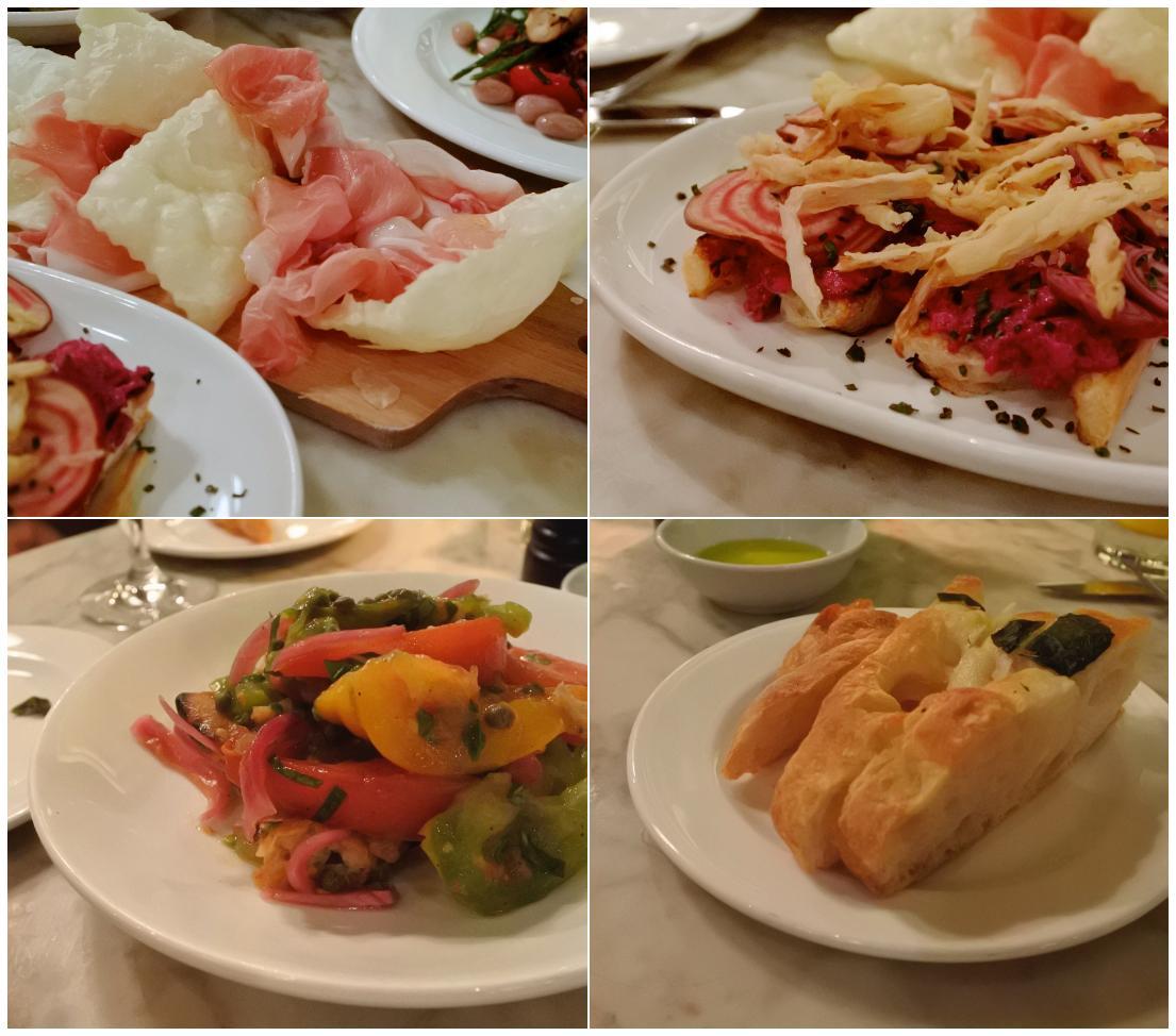 アンティパスティから:左上から時計回りに生ハム+揚げパン、ビートルートのブルシェッタ、突き出しのフォカッチャ、ヘリテージ・トマトのパンツァネッラ・サラダ